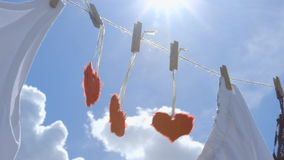 Three Paper Hearts on a Clothesline - symbol for love stock footage