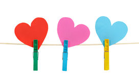 Three paper hearts on clothespins on a rope Royalty Free Stock Image