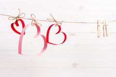 Three paper hearts on the white wooden background, concept for Valentine's day greeting card Stock Photography