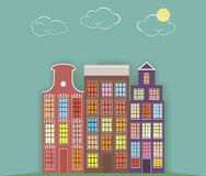 three paper houses on a light background. Royalty Free Stock Image