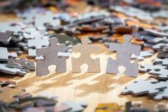 Three paper jigsaw puzzles Stock Photo