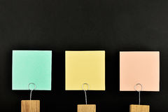 Three paper notes with holder isolated on black for presentation Stock Images