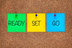 Free Three Paper Notes On Corkboard With Words Ready, Set, Go. Royalty Free Stock Image - 124619996