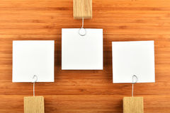 Three paper notesin different directions on wooden background Royalty Free Stock Images