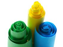 Three paper rolls. Three colorful paper rolls on white stock images