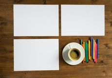 Three paper sheets  , cup of coffee and colored Stock Photo