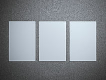 Three paper sheets on gray floor. Royalty Free Stock Photography