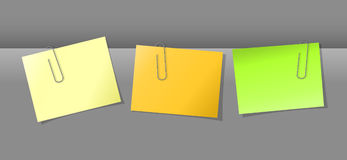 Papers conjunction with paper clips. Three papers conjunction with colored paper clips Royalty Free Stock Photos