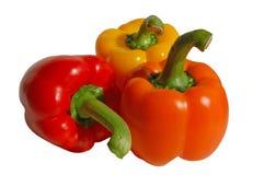 Three paprika. Red, orange, yellow on white background Royalty Free Stock Image
