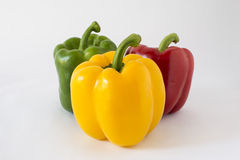 Three paprika. Three sweet pepper and three color red green yellow stock images