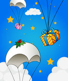 Three parachutes with gifts Royalty Free Stock Image