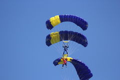 Three parachutists Stock Photo