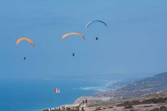Three paragliders at Torrey Pines Gliderport in La Jolla Royalty Free Stock Photo