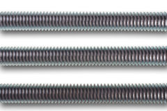 Three parallel screws on white background. royalty free stock images