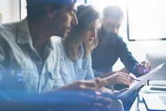 Three partners making research for new business direction.Business people meeting concept.Blurred background. Stock Images
