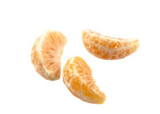 Three parts of tangerine. On the white background Stock Photos