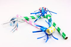 Three Party Favors. Three colorful noise makers on a white background Stock Image