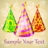 Three party hats & text Stock Images