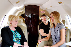 Three passengers on jet enjoying laugh Royalty Free Stock Photo