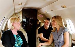 Three passengers on private jet Stock Photos