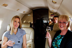 Three passengers in private jet Stock Photography
