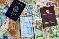 Three Passports and Currency. Three passports with various currencies from Latin America royalty free stock photography