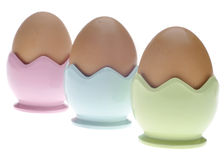 Three Pastel Egg Cups with Brown Eggs Royalty Free Stock Image