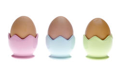 Three Pastel Egg Cups with Brown Eggs Royalty Free Stock Photography
