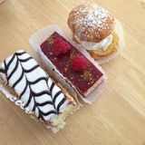 Three pastries sitting on a table Royalty Free Stock Image