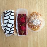 Three pastries sitting on a table Royalty Free Stock Photography