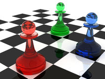 Three pawns made of different colored glass. Colorful chess figures: three classical shape pawns made of different colored glass (RGB color scheme). 3d render Stock Images