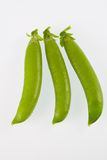 Three pea pods. Isolated on a plain background Royalty Free Stock Image