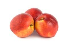 Three peach Stock Images