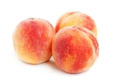 Three peaches Stock Photo