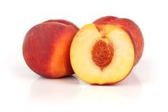 Three peaches. Isolated on white background Royalty Free Stock Photo
