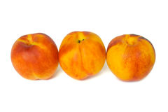 Three peaches Stock Photos