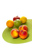 Three peaches and different fruits Stock Photo