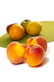 Three peaches and different fruits Stock Image