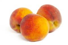 Three peaches isolated. On white background stock photos