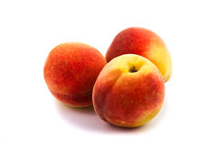 Three peaches isolated on white Royalty Free Stock Image