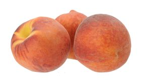Three peaches Stock Images