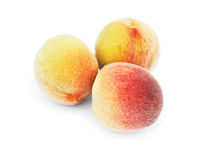 Three peaches. Isolated on a white background Royalty Free Stock Photos