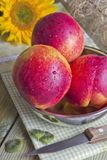 Three peaches on the table. Still life of three peaches on the table Royalty Free Stock Image