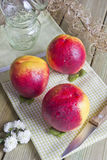 Three peaches on the table. Still life of peaches and three kitchen utensils Royalty Free Stock Photography