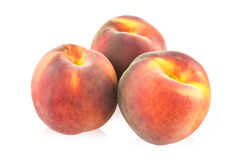 Three peaches Royalty Free Stock Image