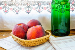 Three Peaches and Wine Bottle Stock Photos