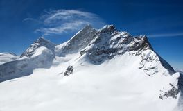 Three peaks in Swiss Alps: Monch, Jungrau, Eiger Royalty Free Stock Photo
