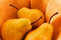 Three pears. In warm light Royalty Free Stock Photography