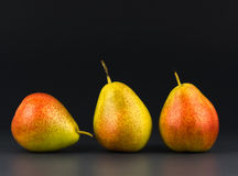 Three pears against  dark background Stock Image