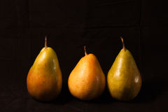 Three Pears on black Royalty Free Stock Photography